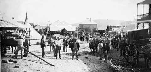 Clarke Street looking south with Captain Gus Pierce's Great Varieties Theatre (tent show, left) and Merlin's photographic cart (right), Hill EndHoltermann Collection, ON 4 Box 10 No 70133